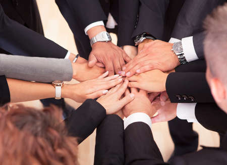 Photo for Group Of Business People With Their Hands Together - Royalty Free Image