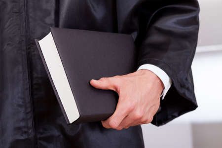 Close-up Photo of Judge Holding The Book