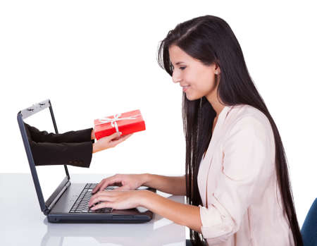 Woman doing online shopping sitting at her laptop