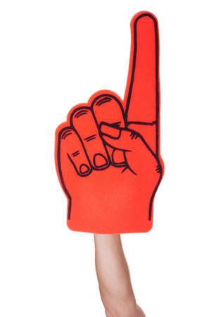 Photo pour Close-up Of Hand Wearing Foam Finger Isolated On White Background - image libre de droit