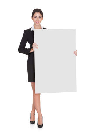 Photo for Happy Smiling Young Business Woman Holding Blank Placard. Isolated On White - Royalty Free Image