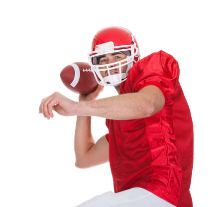 American Football player running with ball. Isolated on white