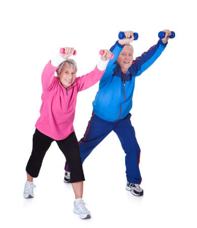 Portrait Of A Senior Couple Exercising On White Backgroundの写真素材