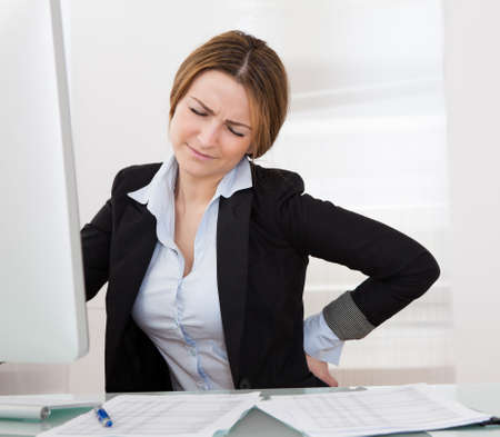 Business Woman With Back Pain Holding Her Aching Hip