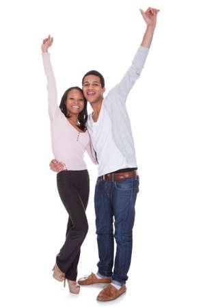 Happy Couple Raising Hand Over White Background