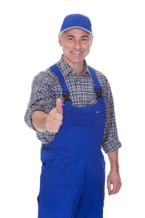Mature Male Technician Making Thumbs Up Gesture Over White Background