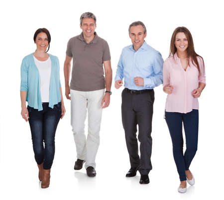 Portrait Of Happy People Walking On White Background