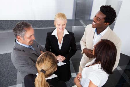 Photo pour Portrait Of Happy Mature Businessman With His Colleagues - image libre de droit