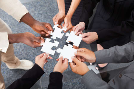 Foto de Close-up Photo Of Businesspeople Holding Jigsaw Puzzle - Imagen libre de derechos