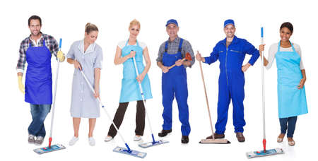 Multi Racial Group Of Cleaners Holding Mop Over White Background
