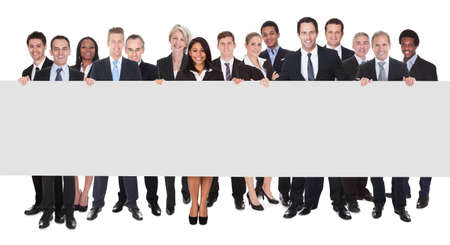 Happy Group Of Businesspeople Holding Placard Over White Background