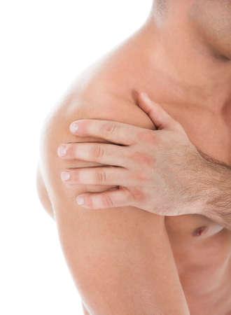 Photo pour Close-up Of A Muscular Young Man Suffering From Shoulder Pain - image libre de droit
