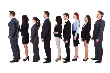Business people standing in queue over white background