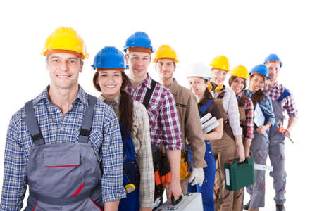 Photo pour Large group of construction workers or workmen and women queuing up in a long line carrying their tool kits as they wait to clock in or be hired for a job  isolated on white - image libre de droit