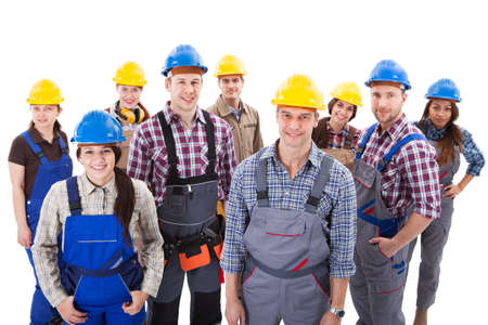 Photo pour Confident diverse team of workmen and women standing grouped in their dungarees and hardhats smiling at the camera  high angle view isolated on white - image libre de droit