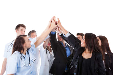 Doctors and managers making high five gesture. Isolated on white