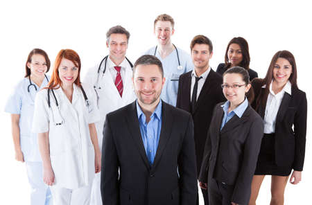 Boss standing on front of his team of doctors and managers