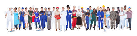 Photo pour Full length of people with different occupations standing against white background - image libre de droit