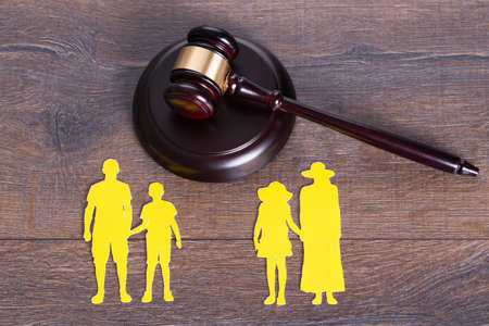 Photo for Gavel on the table and paper family representing divorce - Royalty Free Image