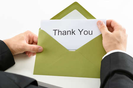 Businessman Holding Thank You Card In Green Envelope