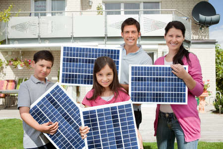 Photo for Photo Of Happy Family Carrying Solar Panels - Royalty Free Image