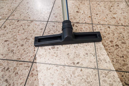 Close-up Of Vacuum Cleaner Over Cleaned Floor