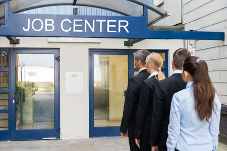 Photo for Group Of Businesspeople Standing In Row Outside The Job Center - Royalty Free Image