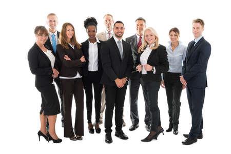 Foto de Full length portrait of confident business team standing against white background - Imagen libre de derechos