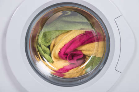 Photo for Closeup of washing machine full of dirty clothes - Royalty Free Image