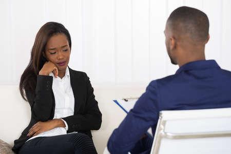 Photo pour Depressed African American Woman At Psychiatrist Appointment - image libre de droit