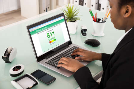 Photo pour Young African Businesswoman Checking Credit Score On Laptop At Office - image libre de droit