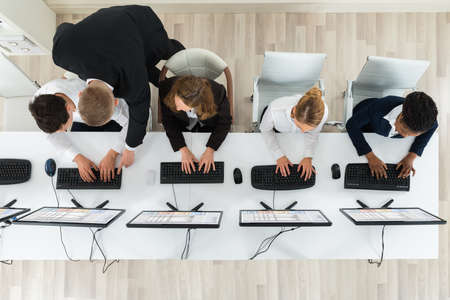 Photo pour High Angle View Of Businesspeople Together Working In The Office - image libre de droit