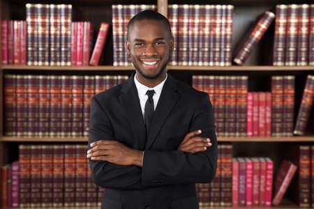 Photo pour Portrait Of Happy Male Lawyer In Office - image libre de droit