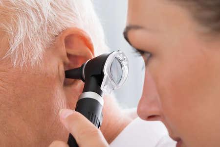 Foto für Close-up Of Female Doctor Examining Patient's Ear With Otoscope - Lizenzfreies Bild