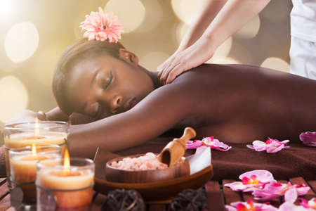 Photo for Young African Woman Receiving Back Massage At Beauty Spa - Royalty Free Image