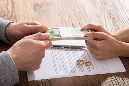 Couple\'s Fighting For Money Over The Divorce Agreement With Gold Wedding Rings