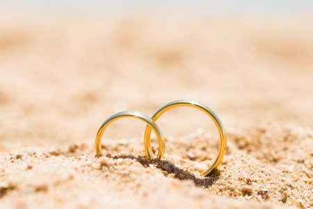 Foto de Two Golden Rings In Sand At Beach - Imagen libre de derechos