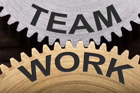 Closeup of team work concept on interlocked cogwheels
