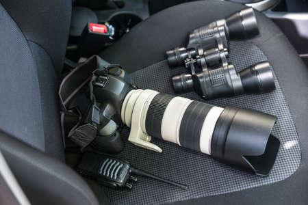 Photo pour Elevated View Of Electronic Equipments On Car Seat - image libre de droit
