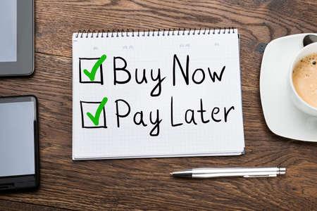 Photo pour Buy Now Pay Later Concept In Notepad At Desk - image libre de droit