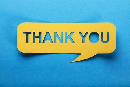 Thank You Text On Yellow Speech Bubble Made Of Paper
