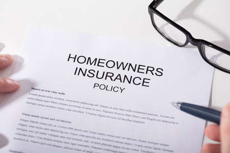 Photo pour Close-up Of Homeowners Insurance Policy Form And Spectacles - image libre de droit