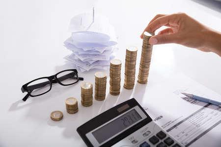 Photo pour Accountant Stacking Coins On Desk. Save Money Concept - image libre de droit