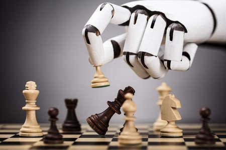Photo pour Close-up Of A Robot's Hand Playing Chess - image libre de droit