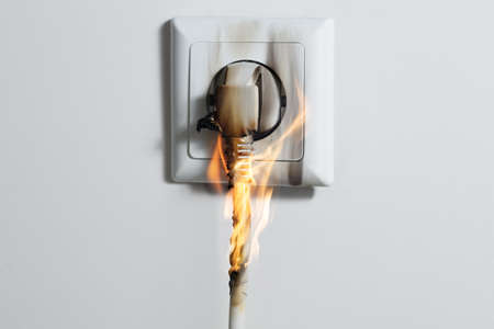 Photo pour Electric Short Circuit Causing Fire On Plug Socket At Home - image libre de droit