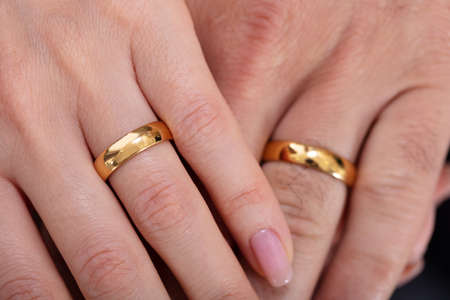 Photo pour High Angle View Of A Couple's Hand Showing Their Wedding Rings - image libre de droit