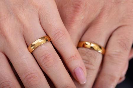 Foto de High Angle View Of A Couple's Hand Showing Their Wedding Rings - Imagen libre de derechos