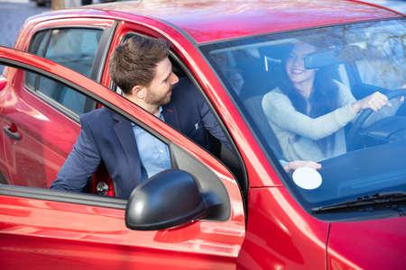 Photo pour Handsome Man In Suit Getting In Car - image libre de droit