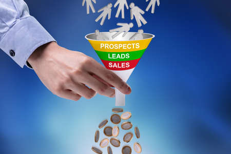 Foto de Close-up Of Businessman Holding Funnel Converting Prospects Into Money - Imagen libre de derechos