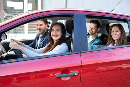 Foto de Group Of Happy Friends Having Fun In The Car - Imagen libre de derechos